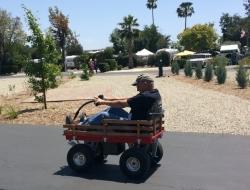 Chuck on Bob's Motorized Wagon Wheels