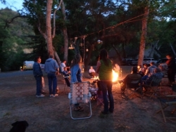 Evening campfire & chandeliers in the trees